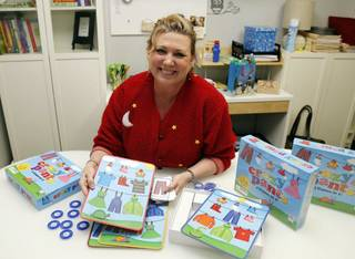 Audiologist Dr. Jacqueline Scholl talks about her game she developed for kids with hearing impairments at her office in Tulsa. Tulsa World - STEPHEN PINGRY