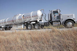 A Blueknight Energy Partners truck transports crude oil to a terminal at Cushing. Photo provided