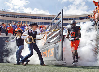 Cowboys enter for field for the football game between the Oklahoma State University Cowboys (OSU) and the University of Kansas Jayhawks (KU) at Boone Pickens Stadium in Stillwater, Okla., Saturday, Oct. 8, 2011 Photo by Steve Sisney, The Oklahoman