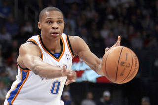 Thunder guard Russell Westbrook passes the ball during Oklahoma City's win over the New York Knicks on Monday. PHOTO BY HUGH SCOTT, THE OKLAHOMAN