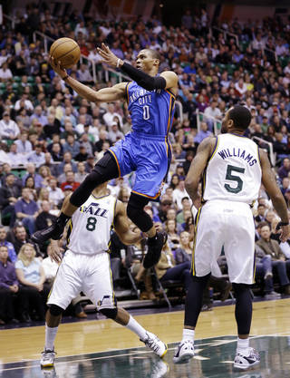Oklahoma City Thunder's Russell Westbrook (0) goes to the basket as Utah Jazz's Randy Foye (8) and Mo Williams (5) watch in the first quarter during an NBA basketball game, Tuesday, April 9, 2013, in Salt Lake City. (AP Photo/Rick Bowmer) ORG XMIT: UTRB106