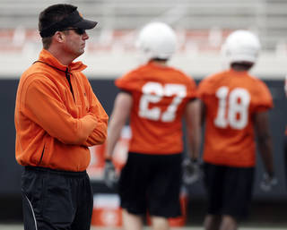 OKLAHOMA STATE UNIVERSITY COLLEGE FOOTBALL: OSU head coach Mike Gundy watches his team during Oklahoma State spring football practice at Boone Pickens Stadium in Stillwater, Okla., Monday, March 7, 2011. Photo by Nate Billings, The Oklahoman ORG XMIT: KOD