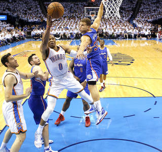 Oklahoma City's Russell Westbrook (0) goes up for a basket as Los Angeles' Blake Griffin (32) defends during Game 5 of the Western Conference semifinals in the NBA playoffs between the Oklahoma City Thunder and the Los Angeles Clippers at Chesapeake Energy Arena in Oklahoma City, Tuesday, May 13, 2014. Photo by Sarah Phipps, The Oklahoman