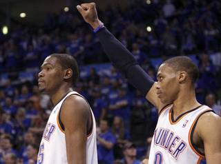 Oklahoma City's Kevin Durant (35) and Russell Westbrook (0) celebrate during the first round NBA basketball playoff game between the Oklahoma City Thunder and the Denver Nuggets on Wednesday, April 20, 2011, at the Oklahoma City Arena. Photo by Sarah Phipps, The Oklahoman SARAH PHIPPS