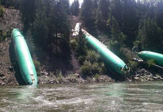 Three of six Boeing 737 fuselages that fell off a derailed freight train onto a step embankment of the Clark Fork River in Montana have posed a recovery challenge for Boeing. AP Photo Jerry Compton - AP