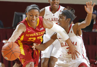 Oklahoma's Aaryn Ellenberg (3) defends on Iowa State's Chassidy Cole (23) during the women's college basketball game between the University of Oklahoma Sooners (OU) and the Iowa State University Cyclones (ISU) at the Lloyd Noble Center on Wednesday, Jan. 4, 2012, in Norman, Okla. Photo by Chris Landsberger, The Oklahoman