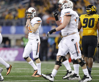 Oklahoma State's Ben Grogan (19) reacts after missing a field goal during the AT&T Cotton Bowl Classic college football game between the Oklahoma State University Cowboys (OSU) and the University of Missouri Tigers at AT&T Stadium in Arlington, Texas, Friday, Jan. 3, 2014. Photo by Bryan Terry, The Oklahoman
