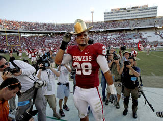 OU's Travis Lewis wears part of the Golden Hat trophy after the Red River Rivalry college football game between the University of Oklahoma Sooners (OU) and the University of Texas Longhorns (UT) at the Cotton Bowl on Saturday, Oct. 2, 2010, in Dallas, Texas. OU defeated Texas 28-20. Photo by Bryan Terry, The Oklahoman