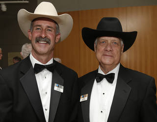 Board of Directors Wyatt McCrea, left, and John Wroten pose for a picture on Saturday during the Western Heritage Awards at the National Cowboy & Western Heritage Museum. Photo by Sarah Phipps, The Oklahoman SARAH PHIPPS - SARAH PHIPPS