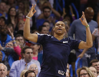 Oklahoma City Thunder guard Russell Westbrook celebrates a Thunder basket from the bench in the first quarter of an NBA basketball game against the Denver Nuggets in Oklahoma City, Monday, March 24, 2014. (AP Photo/Sue Ogrocki)
