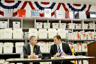 Darrell Sorrels, left, candidate for Oklahoma County sheriff, talks with his attorney, Jared Boyer, at a candidacy hearing Monday. Photo by Zeke Campfield, The Oklahoman