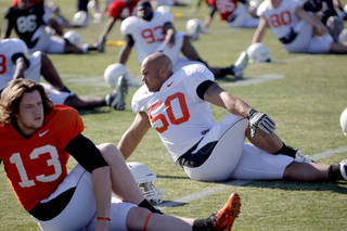 OKLAHOMA STATE UNIVERSITY / OSU / COLLEGE FOOTBALL: Oklahoma State's Quinn Sharp (13) and Oklahoma State's Jamie Blatnick (50) stretch during the Oklahoma State Cowboys practice for the Fiesta Bowl at Scottsdale Community College in Scottsdale, Ariz., Tuesday, Dec. 27, 2011. Photo by Sarah Phipps, The Oklahoman