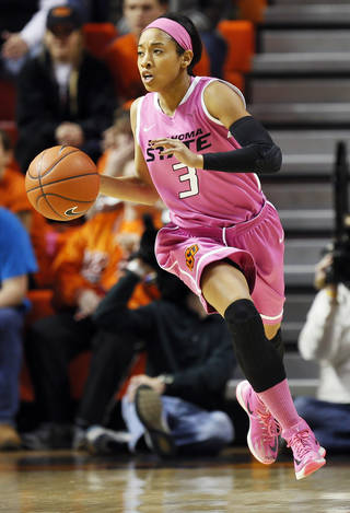 Oklahoma State's Tiffany Bias (3) dribbles the ball in the first half during the women's Bedlam college basketball game between the OU Sooners and the OSU Cowgirls at Gallagher-Iba Arena in Stillwater, Okla., Sunday, Feb. 16, 2014. Photo by Nate Billings, The Oklahoman