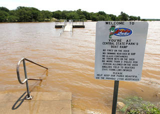 The boat dock and fishing pier were submerged in Central State Park at Arcadia Lake after storms dumped up to eight inches of rain on May 31. Photo by Paul Hellstern, The Oklahoman PAUL HELLSTERN - Oklahoman