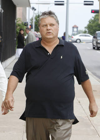 Teddy Mitchell is to be sentenced Friday. He is shown here leaving the Oklahoma City federal courthouse in July after his youngest son pleaded guilty to a tax charge. PAUL B. SOUTHERLAND - PAUL B. SOUTHERLAND