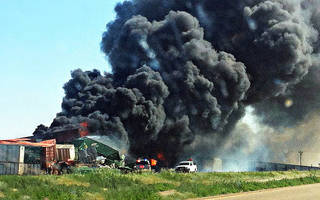 Smoke rises from two freight trains that collided June 24 near Goodwell. The National Transportation Safety Board said Monday the trains weren't speeding at the time of the wreck. Archive Photo By Trudy Hart, The Guymon Daily Herald/AP