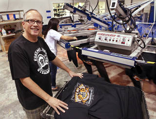 Eskimo Joe's founder Stan Clark started Eskimo Joe's Promotional Products printing facility in Stillwater as a way to keep the printing presses busy when Eskimo Joe's T-shirts were not being made. Photos by Jim Beckel, THE OKLAHOMAN