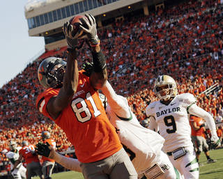 OSU's Justin Blackmon (81) makes a touchdown catch in the second quarter despite the defense of Baylor's K.J. Morton (8) near Chance Casey (9) during a college football game between the Oklahoma State University Cowboys (OSU) and the Baylor University Bears (BU) at Boone Pickens Stadium in Stillwater, Okla., Saturday, Oct. 29, 2011. Photo by Nate Billings, The Oklahoman