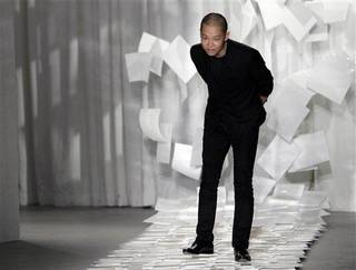 "FILE - In this Sept. 9, 2011 file photo, designer Jason Wu takes a bow after presenting his Spring 2012 collection during Fashion Week in New York. Judges in his native Taiwan seem unimpressed that Wu has designed two inaugural gowns for U.S. first lady Michelle Obama. Taiwan's Intellectual Property Court ruled Monday, Jan. 21, 2013 that Wu's new label ""Miss Wu"" could not be registered as a brand because it was not distinctive enough. He designed the white gown Michelle Obama wore for her husband's first inauguration in 2009. On Monday, she appeared in another of his creations, a shiny gown with a red halter top. (AP Photo/Mary Altaffer, File)"
