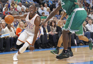 Oklahoma City Thunder guard Reggie Jackson (15) drives past Boston Celtics power forward Kevin Garnett (5) during the NBA basketball game between the Oklahoma City Thunder and the Boston Celtics at the Chesapeake Energy Arena on Wednesday, Feb. 22, 2012 in Oklahoma City, Okla. Photo by Chris Landsberger, The Oklahoman