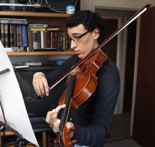Ulises Serrano, a college student at Oklahoma City University, practices the viola at his home in Edmond, OK, Friday, June 7, 2013, Photo by Paul Hellstern, The Oklahoman
