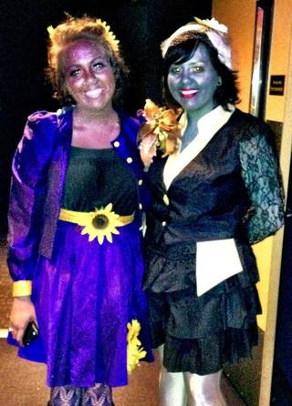 """Two fans dressed in the gaudy makeup and fashions of the movie's Capitol citizens to attend a midnight screening of """"The Hunger Games"""" last March at Harkins Bricktown 16. Photo provided by Harkins."""