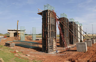 Columns are going up to form an elevated connection between Interstate 40 south of Lower Bricktown and the future downtown boulevard. Photos by Nate Billings, The Oklahoman NATE BILLINGS -