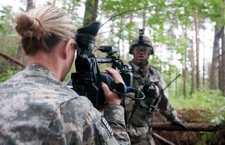 SecondLt. Leanna Litsch, of Altus, interviews a soldier in Rukla, Lithuania, on June 14. Litsch belongs to the 145th Mobile Public Affairs Detachment, which was sent to four countries to tell the story of the 173rd Airborne Brigade and their training in the Baltic region. PHOTO BY SGT. DANIEL NELSON, OKLAHOMA ARMY NATIONAL GUARD Sgt. Daniel Nelson - Sgt. Daniel Nelson, 145 MPAD, Oklahoma Army National Guard