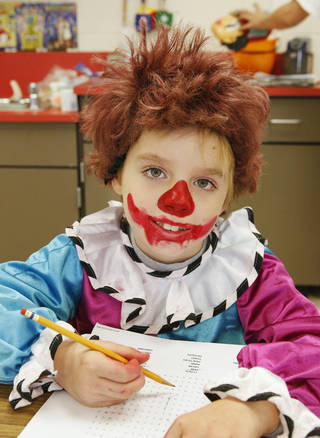 Second-grader Cole Phillips, 7, wears a clown costume while doing class work at Hayes Elementary in Oklahoma City on Wednesday. PAUL B. SOUTHERLAND - PAUL B. SOUTHERLAND