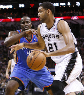 San Antonio's Tim Duncan (21) goes past Oklahoma City's Kendrick Perkins (5) during Game 1 of the Western Conference Finals in the NBA playoffs between the Oklahoma City Thunder and the San Antonio Spurs at the AT&T Center in San Antonio, Monday, May 19, 2014. Photo by Sarah Phipps, The Oklahoman
