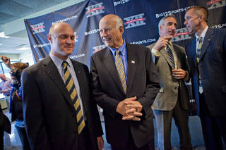 West Virginia President James Clements, left, talks with Big 12 Interim Commissioner Chuck Neinas following a press conference to announce the school's entrance into the conference Tuesday, Nov. 1, 2011, in Morgantown, W.Va. At right are West Virginia Athletic Director Oliver Luck, second from right, and Big 12 Deputy Commissioner Tim Weiser. (AP Photo/David Smith) ORG XMIT: WVDS105