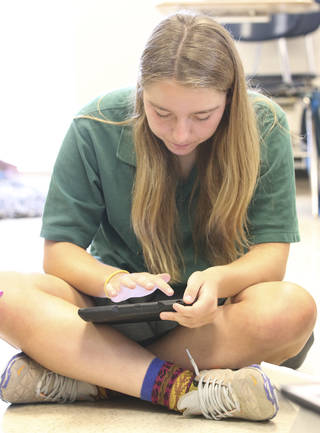 Bishop McGuinness Catholic High School sophomore Meghan Ciupak works on her iPad on Tuesday. McGuinness issued iPads to all its students this year. Photo By Steve Gooch, The Oklahoman Steve Gooch - The Oklahoman