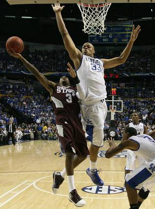 Kentucky's Daniel Orton (33) defends against the shot of Mississippi State's Dee Bost (3) in the second half of an NCAA college basketball game on Sunday, March 14, 2010, at the Southeastern Conference tournament in Nashville, Tenn. (AP Photo/Dave Martin)