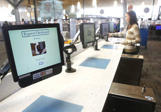 A customer uses the the self pickup area at Northwest Library, 5600 NW 122. By Paul Hellstern, The Oklahoman PAUL HELLSTERN - Oklahoman