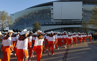 Above: The Oklahoma State University marching band makes its way to AT&T Stadium on Friday before the AT&T Cotton Bowl Classic between OSU Cowboys and the University of Missouri Tigers in Arlington, Texas. Photo by Bryan Terry, The Oklahoman