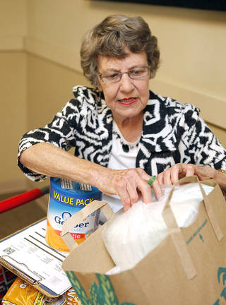 Martha King, of Oklahoma City, checks out items for a client at Infant Crisis Services. King won a senior volunteer award for her work at the Oklahoma City nonprofit. Photo by Paul Hellstern, The Oklahoman PAUL HELLSTERN - Oklahoman