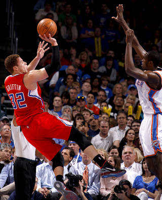 Los Angeles' Blake Griffin (32) puts up a shot beside Oklahoma City's Serge Ibaka (9) during the NBA basketball game between the Oklahoma City Thunder and the Los Angeles Clippers at Chesapeake Energy Arena in Oklahoma City, Wednesday, April 11, 2012. Photo by Bryan Terry, The Oklahoman