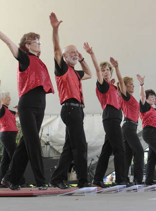 From left, Marti Hole, Fred Cherry, Mary Burleson, Jan Draper and Sharon Graham with The Okie Stompers perform at the annual May Fair Festival Saturday at Andrews Park in Norman. PHOTO BY STEVE SISNEY, THE OKLAHOMAN STEVE SISNEY