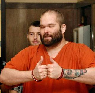 Richard Lynn Dellert, front, gives two thumbs up as he is led to court for his sentencing in an assault case in Oklahoma County District Court. A sheriff's deputy later told him to cool it. Behind him is Zachary Chase Provence, who admitted to hitting the victim with a baseball bat. JIM BECKEL - THE OKLAHOMAN