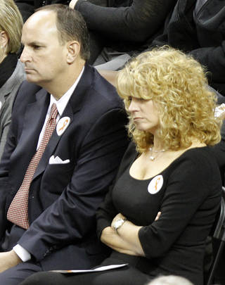 OKLAHOMA STATE UNIVERSITY / OSU / WOMEN'S COLLEGE BASKETBALL COACH / ASSISTANT COACH / AIRPLANE / PLANE CRASH / DEATHS / PAULA BRANSTETTER: University of Oklahoma (OU) athletic director Joe Castiglione and women's basketball coach Sherri Cole attend the memorial service for Oklahoma State head basketball coach Kurt Budke and assistant coach Miranda Serna at Gallagher-Iba Arena on Monday, Nov. 21, 2011 in Stillwater, Okla. The two were killed in a plane crash along with former state senator Olin Branstetter and his wife Paula while on a recruiting trip in central Arkansas last Thursday. Photo by Chris Landsberger, The Oklahoman ORG XMIT: KOD