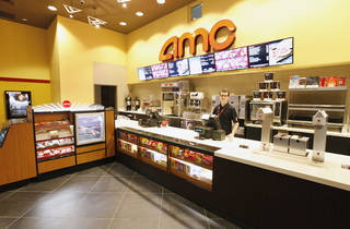 Kenneth Thacker, AMC Theatre senior manager, stands at the remodeled concession counter in the AMC theater at Penn Square Mall. PAUL B. SOUTHERLAND - PAUL B. SOUTHERLAND