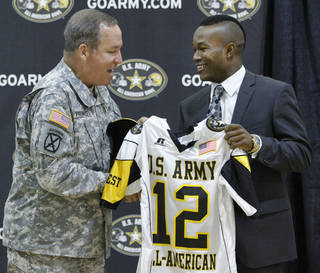 Lt. Gen. Benjamin C. Freakley presents an Army All-American jersey to Barry Sanders during a ceremony at Heritage Hall High School in Oklahoma City , Monday, October 4, 2011. Photo by Steve Gooch Steve Gooch