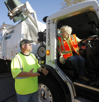Former Mayor Saundra Naifeh, president of Edmond Beautiful, speaks to Jeff Whitfield, Edmond sanitation truck driver. Naifeh and other members of Edmond Beutiful rode on trash trucks Friday to raise awareness to bag and tie trash. PHOTO BY PAUL HELLSTERN, THE OKLAHOMAN. PAUL HELLSTERN - OKLAHOMAN