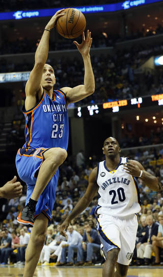 Oklahoma City's Kevin Martin (23) over to the hoop in front of Memphis' Quincy Pondexter (20) during Game 3 in the second round of the NBA basketball playoffs between the Oklahoma City Thunder and Memphis Grizzles at the FedExForum in Memphis, Tenn., Saturday, May 11, 2013. Photo by Nate Billings, The Oklahoman