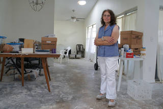 Linda Lipofsky, of Orlando, stands in the home that hurricanes destroyed in 2004. After eight grueling years, during which time a contractor ran off with the insurance money before finishing the job, she is moving back in thanks to the heroic efforts of Rebuilding Together. Photo courtesy of Rebuilding Together.