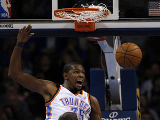 Oklahoma City's Kevin Durant reacts after a dunk during Sunday's game at Chesapeake Energy Arena. Photo by Sarah Phipps, The Oklahoman
