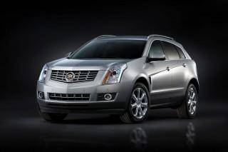 A 2013 Cadillac SRX SUV is shown. General Motors is recalling 50,000 luxury SUVs. AP File Photo