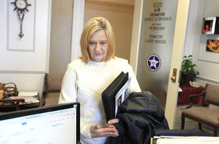"Ginger Harper, Lindsay, visits the office of her state senator, Sen. Corey Brooks, R-Washington, to lobby in support of Senate Bill 2116 to legalize marijuana at the state Capitol in Oklahoma City Wednesday, Feb. 12, 2014. Supporters converged on the state Capitol to personally lobby their legislators to reform Oklahoma's strict marijuana laws during ""Medical Marijuana Lobby Day."" Ginger suffers from Tardive dyskinesia and would like to use marijuana to help manage symptoms of the disease. Photo by Paul B. Southerland, The Oklahoman"