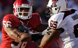 Oklahoma's Ronnell Lewis (56) takes on Texas Tech's LaAdrian Waddle (65) during the first half of the college football game between the University of Oklahoma Sooners (OU) and the Texas Tech Red Raiders (TTU) at the Gaylord Family-Oklahoma Memorial Stadium on Saturday, Nov. 13, 2010, in Norman, Okla. Photo by Chris Landsberger, The Oklahoman