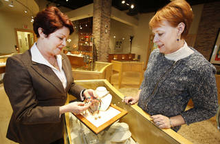 Dr. Nancy Nagle, left, looks at a piece of jewelry with Pam Wiggins at Naifeh Fine Jewelry. Photo By Steve Gooch, The Oklahoman